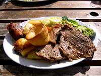 ''The quintessential English Sunday lunch. w:Roast beef, roast potatoes, vegetables and w:yorkshire pudding. Actually, the beef was kind of tough.'' Photo from flickr: http://flickr.com/ph