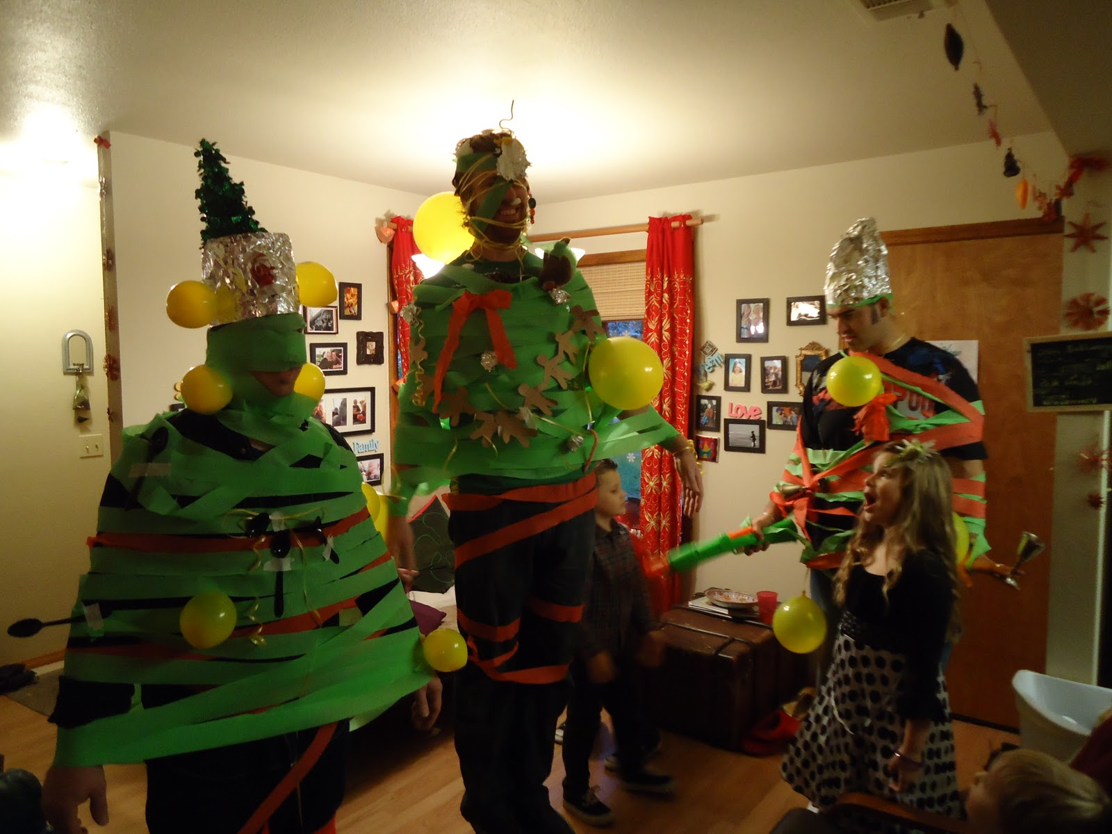 Christmas tree dress up images - Christmas Tree Game Rules Find A Man And Dress Him Up As A Christmas Tree Using Crepe Paper Balloons And Any Other Objects That You Can Sneak In
