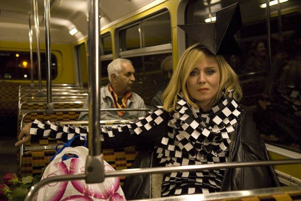 Roisin Murphy wearing Gareth Pugh dress on a bus