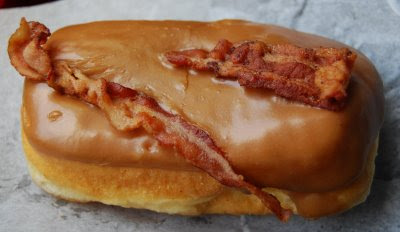 Raised yeast doughnut with maple frosting and bacon on top!