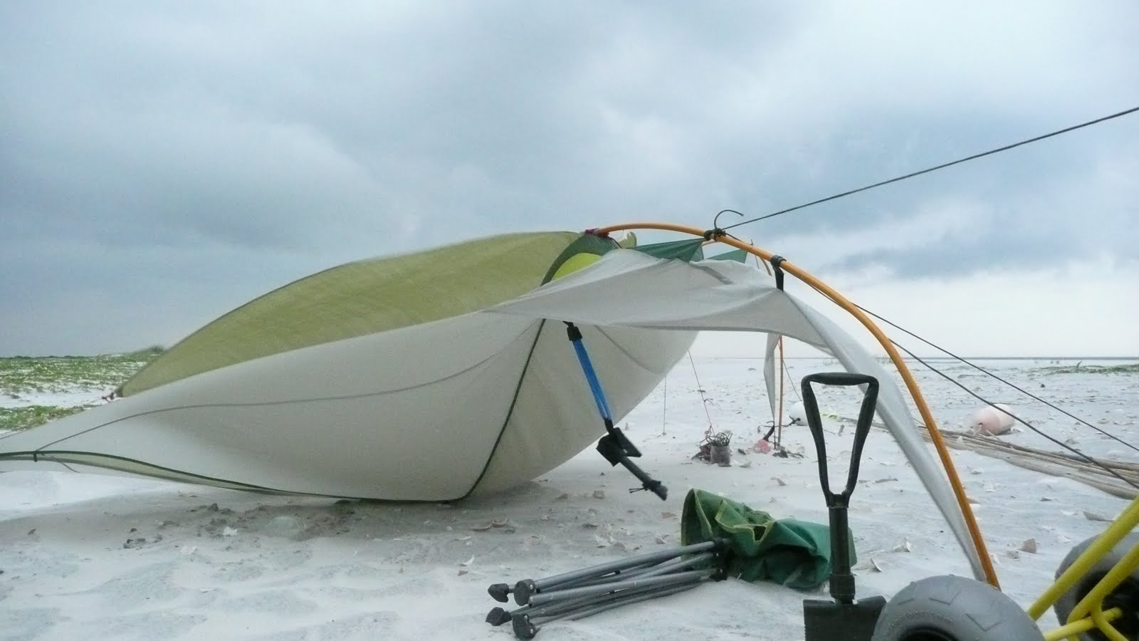 High winds just about wreck my shade structure. The wind is blowing stinging sand against my face and legs. The sky is getting darker clouds moving with ... & Horn Island Day Two | Robot on Holiday