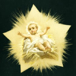 Just born Jesus Christ smiling in the bright golden manger with black background religious Christian photo
