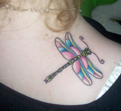 dragonflies tattoo. large dragonfly tattoo on the