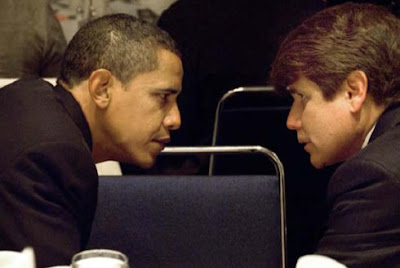 Governor Blagojevich confers with now President‐Elect Barack Obama