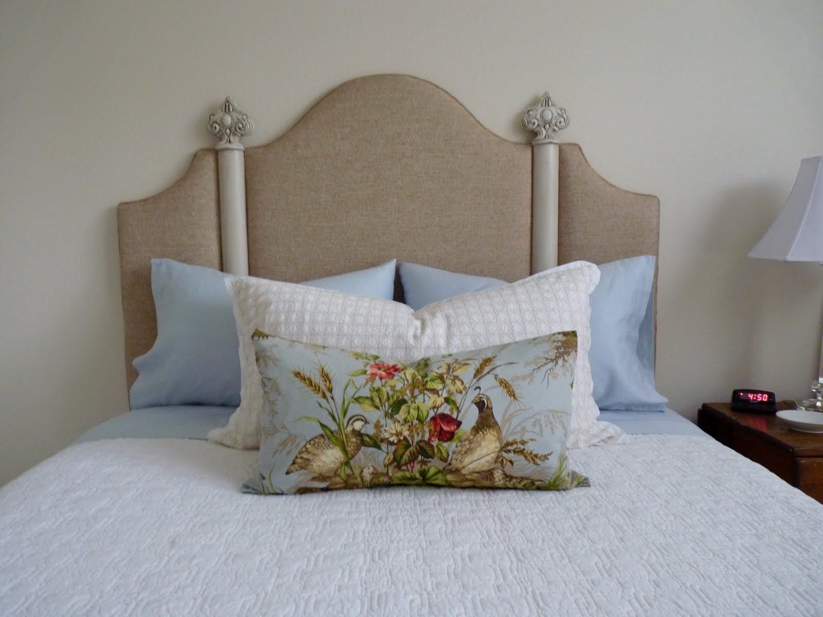 rowley company custom headboard with decorative hardware