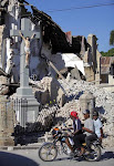 Crucifix left standing in rubble of cathedral in Port au Prince