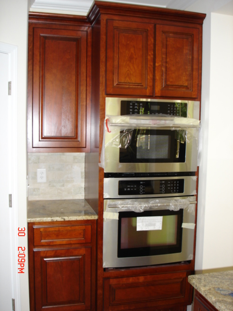 Cherry kitchen cabinets refinishing wonders call us for Kitchen cabinets estimate
