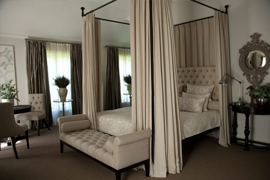 Cream curtains offer a touch of opulence and refinment to four poster beds
