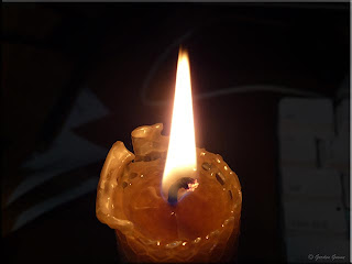 homemade beeswax candle burning