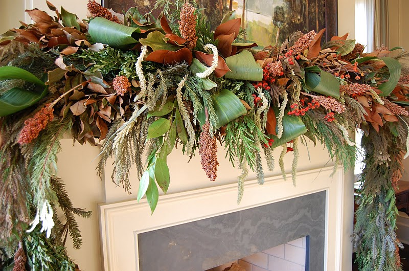 it inspired me to make one with items from our yard i got busy pruning everything i could find that wasnt an evergreen the garage was already full of