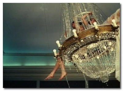 swinging in a chandelier