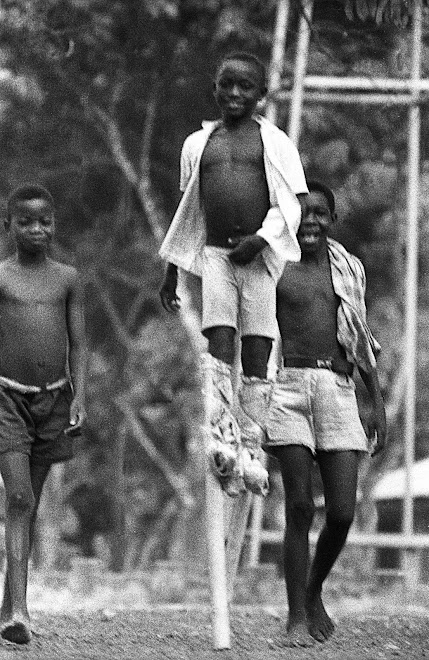 schoolboys on stilts - Kenema