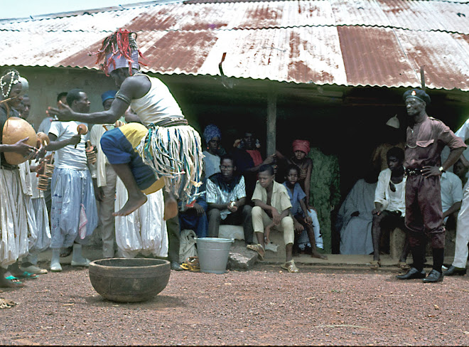 Fula acrobat at Pa Maju Bah's house in Kenema