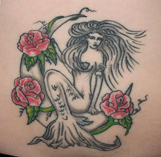 mermaid with flower tattoo