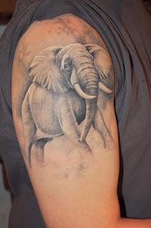 elephant tattoo on hand for male