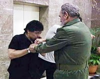 Maradona in hand kissing Cuban leader Fidel Castro