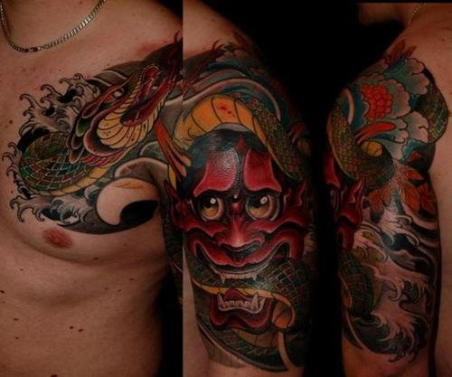 samurai dragon arm tattoo. colorful arm tattoo by dublin ireland tattoo