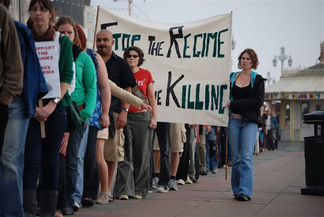 "THE BANNER SILENTLY SCREAMS OUR FEELINGS "" STOP THE REGIME STOP THE KILLING""."