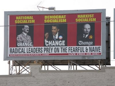 The North Iowa Tea Party began displaying the billboard in downtown Mason City last week. The sign shows large photographs of Obama, Nazi leader Hitler and communist leader Lenin beneath the labels Democrat Socialism, National Socialism, and Marxist Socialism.  Beneath the photos is the phrase, Radical leaders prey on the fearful &amp; naive. (AP Photo/Globe Gazette, Deb Nicklay)