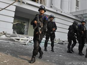 Counter-terrorist police commandos secure the damaged Ritz-Carlton hotel in Jakarta on Friday after the blasts