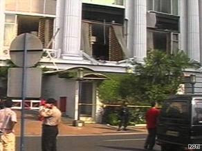 Damage to the Ritz-Carlton Hotel can be seen following the blast
