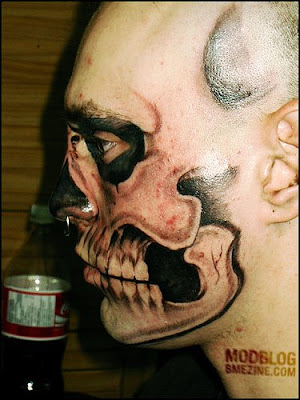 It's the scariest human head I've ever seen. The tattoo was crafted by the