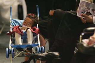 little Jackie Garcia sleeps through her father's funeral