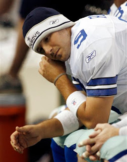 Tony Romo may look sad, but he's going home to fuck Jessica Simpson