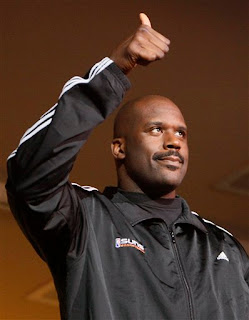 Shaq gives the thumbs up to the Phoenix crowd which cheered him as he sat in a luxury box during the game