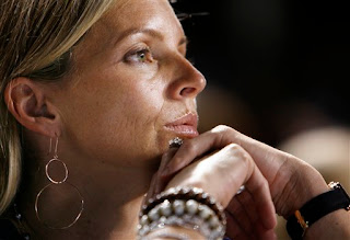 Tom Glavine's wife Christine watches anxiously, this must have been when Mota came into the game