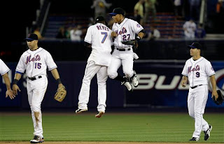 Jose Reyes and Carlos Gomez celebrate a victory over the Twins on June 18