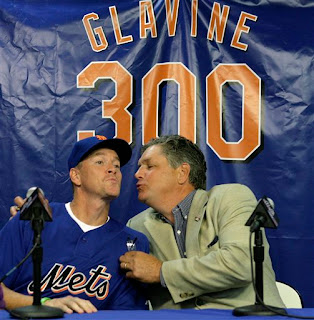 Glavine gets a kiss from Tom Seaver