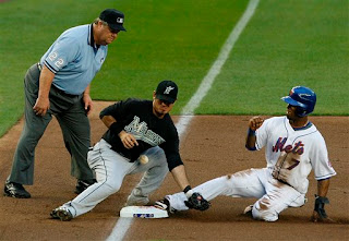 Joe West gets a great view of Reyes sliding in safely to third