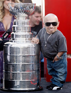 Mini Me Verne Troyer poses with the Stanley Cup at the Premiere of the Love Guru
