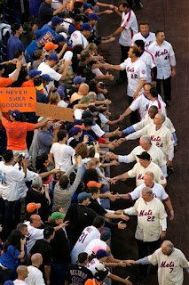 Some of the Mets greatest players shake hands with the fans