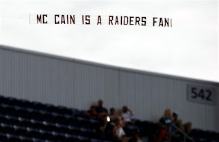 McCain is a Raiders fan sign flies over Invesco Field
