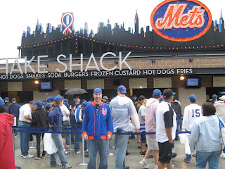 in front of Shake Shack and the skyline from Shea Stadium