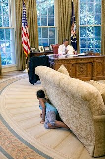 Sasha Obama sneaking around the Oval Office