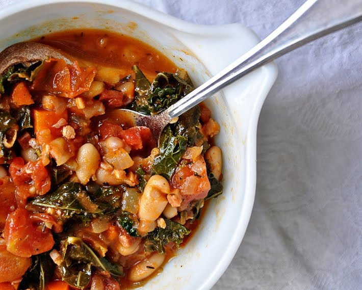 "Translated, Ribollita means ""reboiled"". It is a Tuscan peasant soup..."