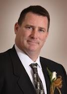 Mark E. Roy
