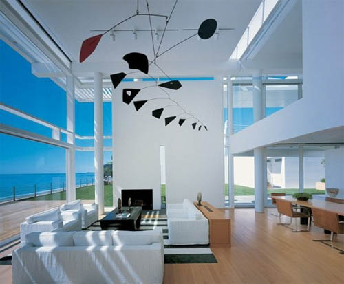 White-modern-house-beach-living-room-with-fantastic-design-with-white-walls-wooden-flooring-contemporary-sofas-windows-and-dining-area
