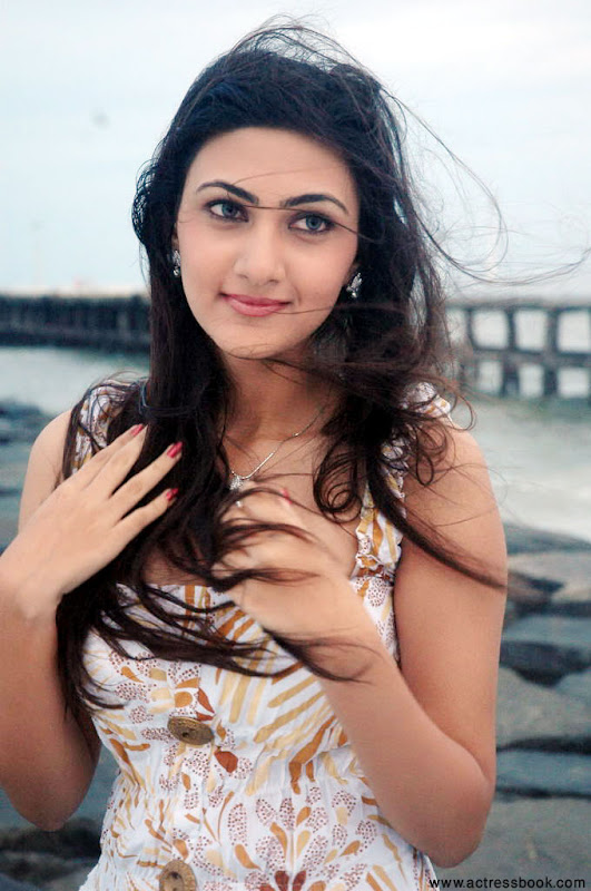 Neelam  South Telugu Cute Actress Sexy In Beach Stills navel show