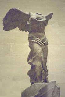 At the L'ouvre, I stood at the foot of a grand, marble staircase in awe of the Winged Victory gracing the landing above