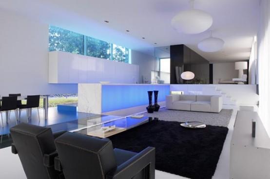 Casas minimalistas y modernas casa futurista iluminada for Casas modernas futuristas