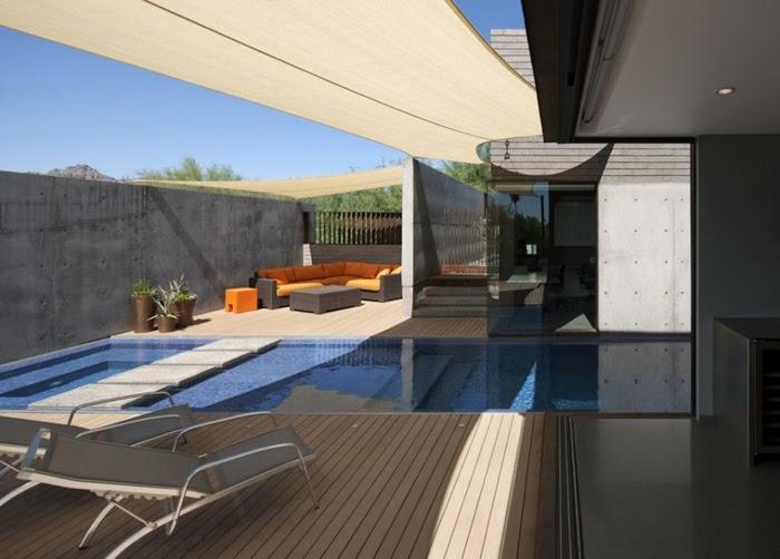 Casas minimalistas y modernas piscinas en patios for Casas modernas con piscina interior