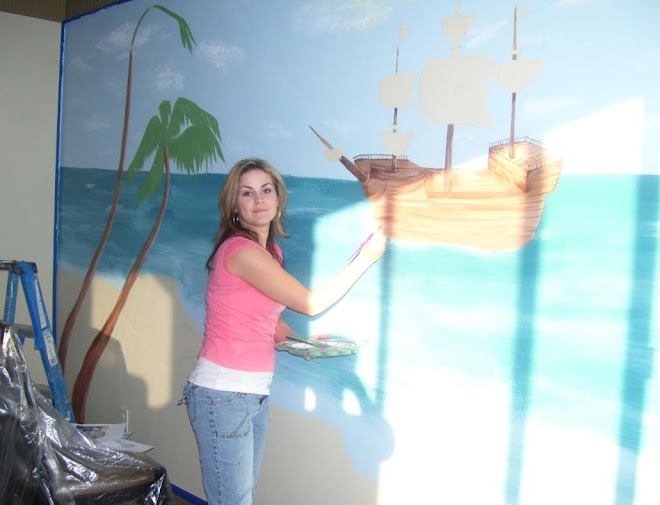Eva working on a pirate ship mural