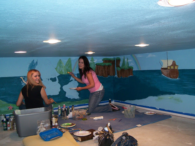 Eva and amy working on a fantasy mural for a children's playroom