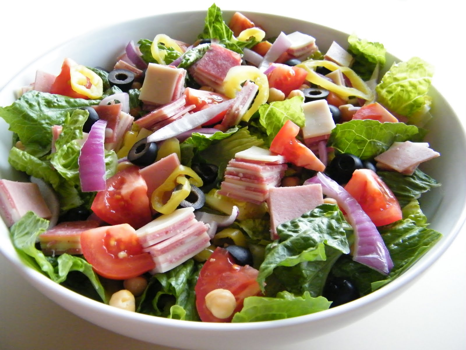 One of my favorite salads to eat in the summer is an antipasto salad.