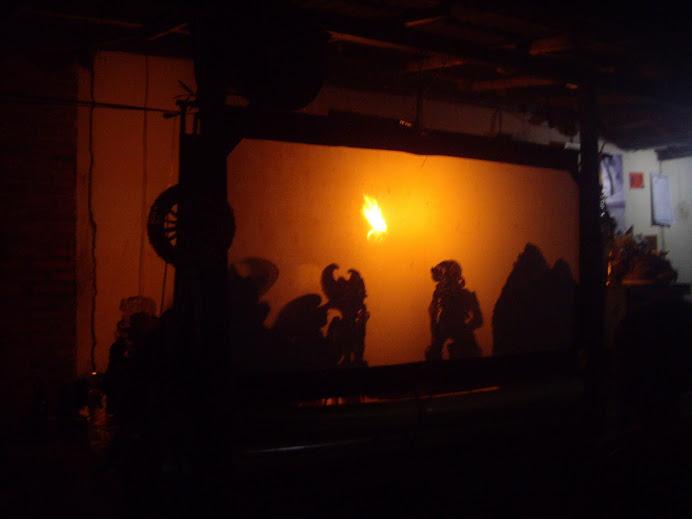 SACRED WAYANG KULIT SHADOW PLAY PERFORMANCE AT A HOME COMPOUND IN SERIRIT, BALI.