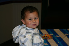 This is a pic of Isaac on his third birthday at his favorite place Chucky Cheese